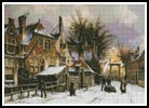 A Townview with figures on a snow covered street - Cross Stitch